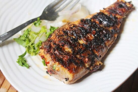 GRILLED FISH Served with Rice  Served with rice of your choice small chips ,accompanied with beans, isombe and dodo, Price : 5,500 Frw, Free Delivery