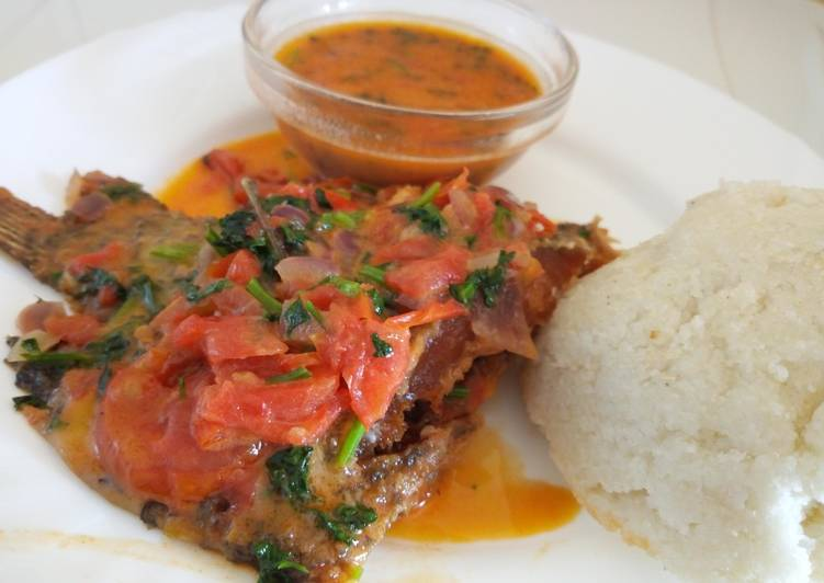 GRILLED FISH  Served with ugali accompanied with beans, isombe and dodo, Price: 6,000 frw, Free DeliverY